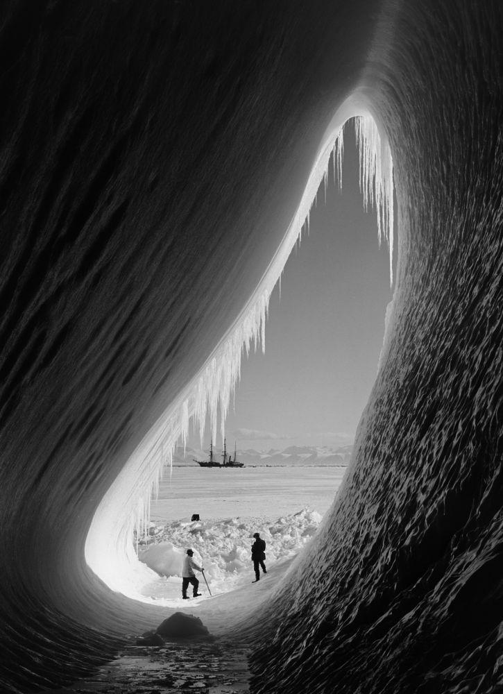 grotto in an iceberg. antarctica, 1911. credit: herbert ponting.