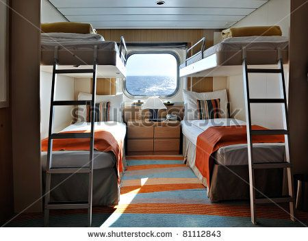 Interior Of A Living Cabin On A Cruise Ship With Bunk Beds And