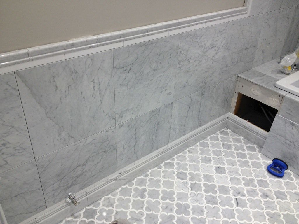 Tile install white marble bathroom river city tile company katie 39 s bathroom pinterest Bathroom wall tiles laying designs