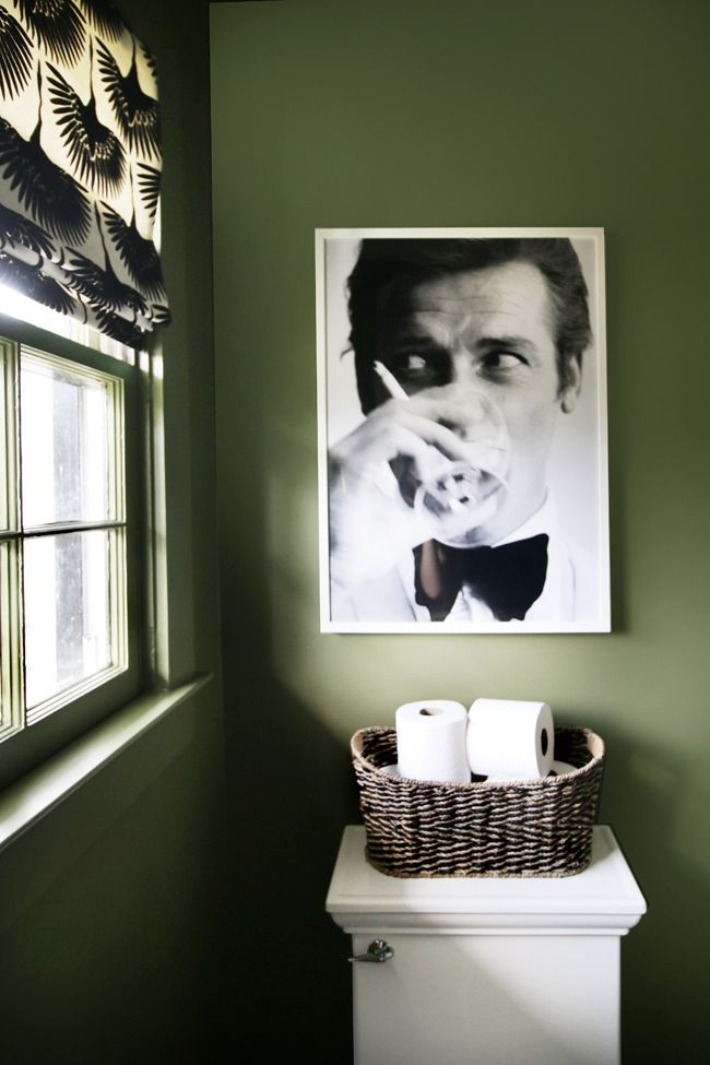 Love quirky art in the bathroom thyme green walls roger moore art tonic living roman shade