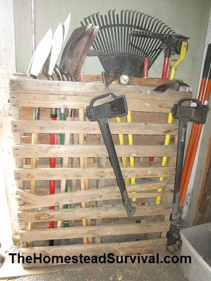 simple wood pallet tool organizer idea using a simple wood pallet as a yard tools organizer is a great way to safely keep tools up off the floor of a garag