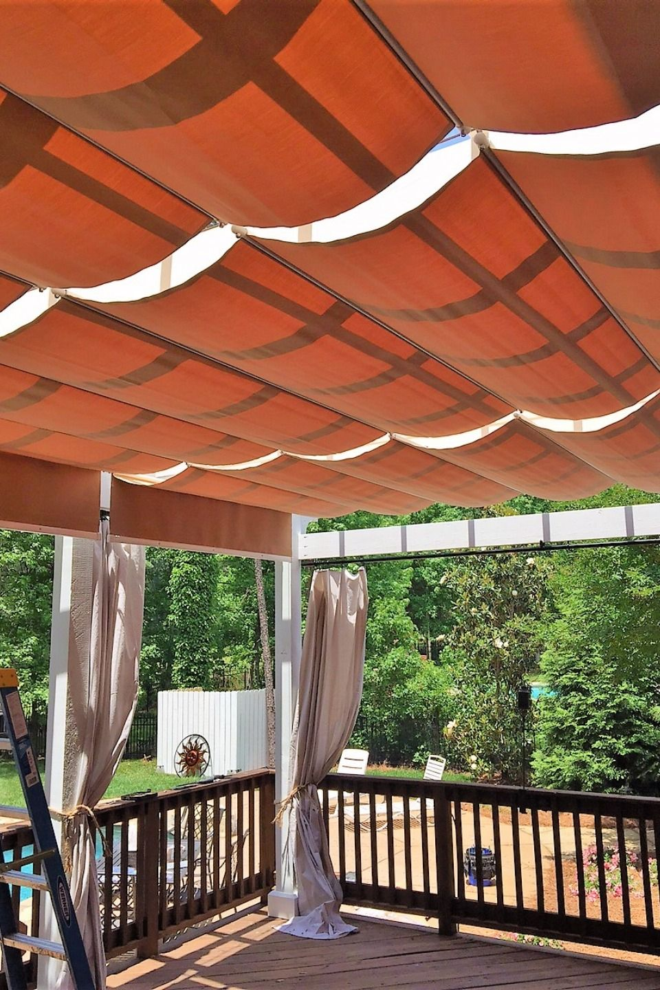 This beautiful CableShade system uses waterproof fabric ...