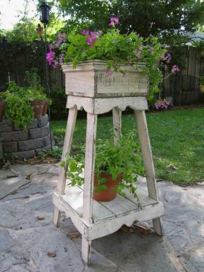 Plant Stands double as both a stylish garden feature and functional design idea for small spaces. Stacking plants vertically saves space. More inspiring variations on this idea @ http://themicrogardener.com/add-space-creative-vertical-gardens-part-2/ | The Micro Gardener