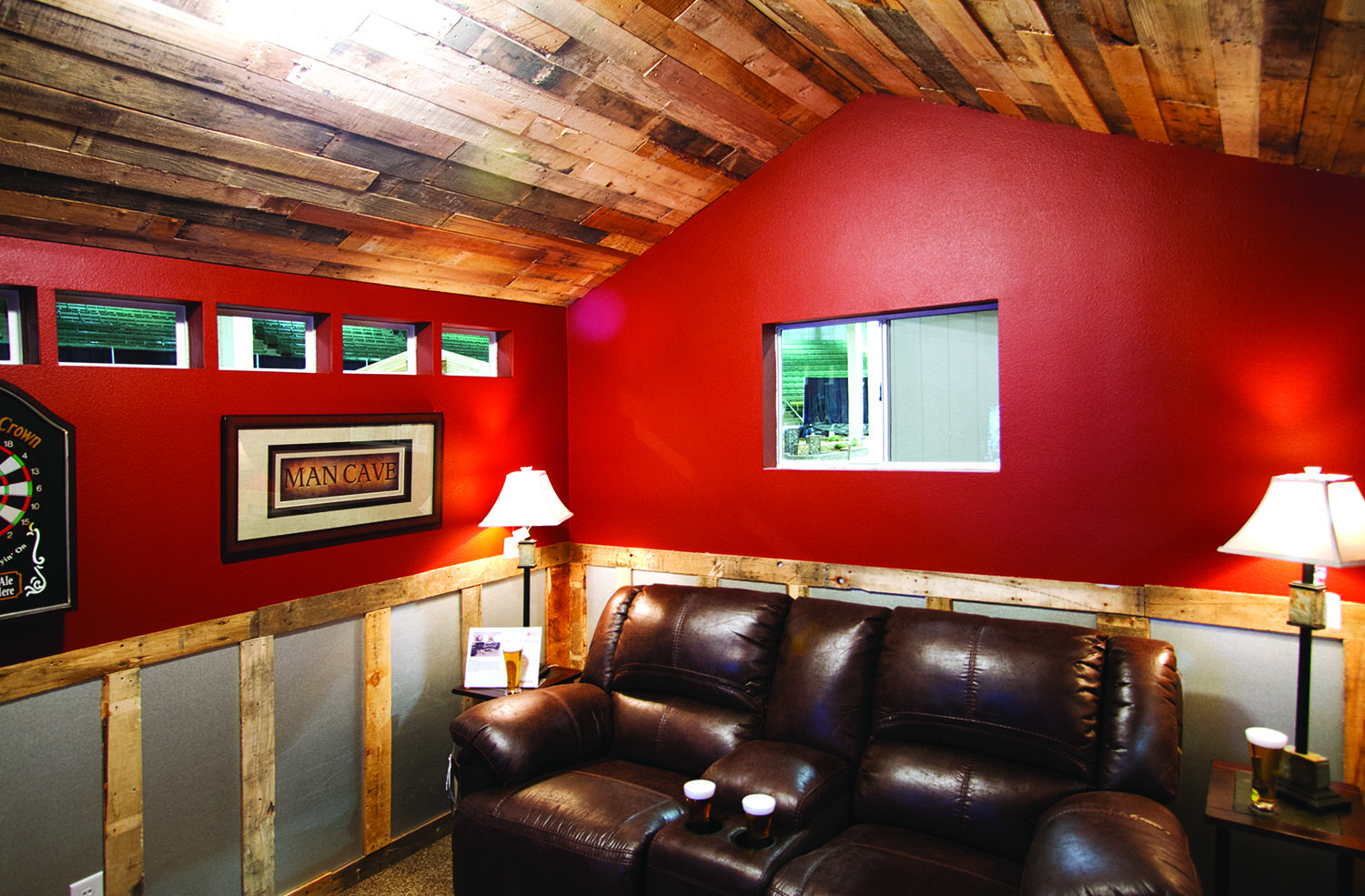 Man Cave complete with pallet ceiling, recliner, and a cold drink or two. Nothing better. #garagemancaves