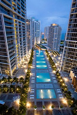The two-acre pool deck at the Viceroy Miami features Japanese blueberry trees, swanky chaise lounges and beds, and three types of pools: an 80-person hot tub, a wading pool, and a football-field-size swimming pool. (Courtesy Viceroy Miami) I want to go here some day...