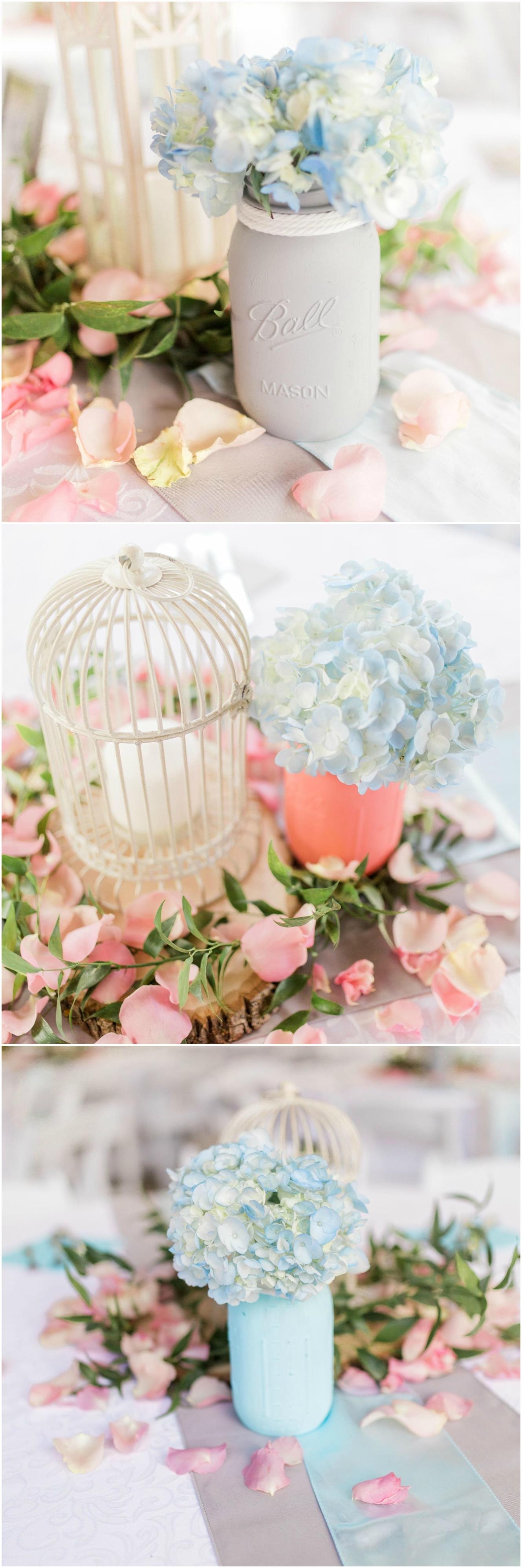 Weddingcenterpieces, painted mason jars, white birdcage, blue hydrangeas, pink rose petals // Jyn Allen Photography