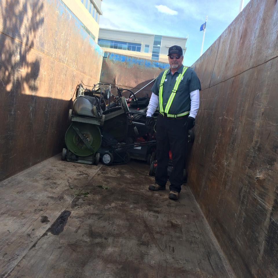Ed Larrat of Salt Lake County Health Department loads the