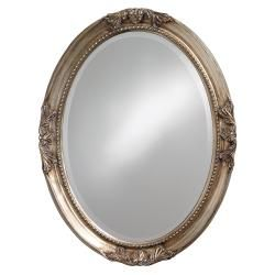 This traditional Lisette mirror features a scroll-detailed warm antique silver-finished wood frame. Sure to compliment any room's decor, this mirror can be hung either vertically or horizontally.