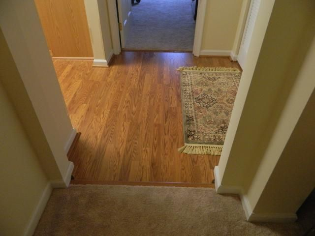 Harvest Oak Strip Laminate in this Bel Air Maryland Hall Transitions to  Beautiful New Bedroom Carpet. laminate living room hall carpet   Google Search   Downstairs