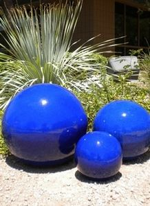 Blue Garden Spheres I D Like Two To Nest In The Middle Of Clumps Of Golden Grass Like Eggs In A Nest Garden Spheres Blue Garden Garden Ornaments
