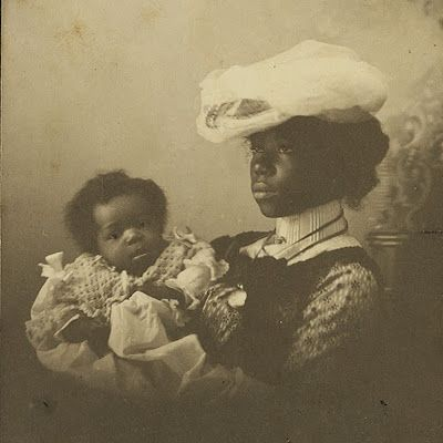 Mother and child, circa 1890s.  How often do you see photos like this of well-off black family before the turn of the century? And dark-skinned too!