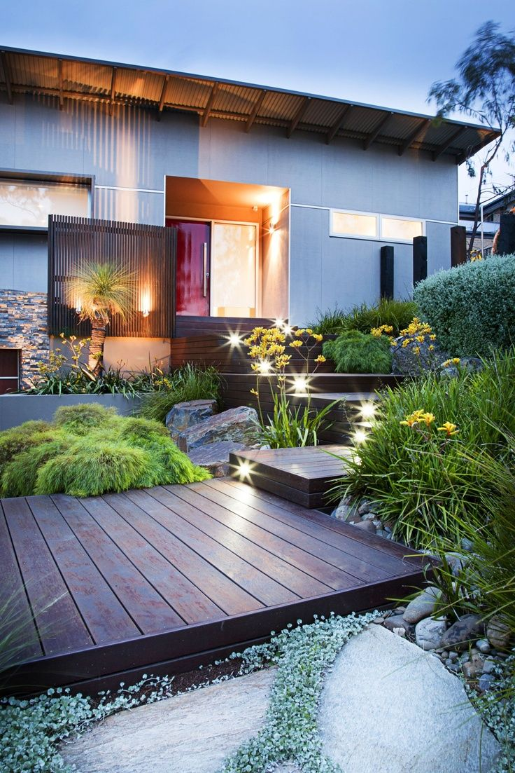 front yard landscaping with wooden platforms
