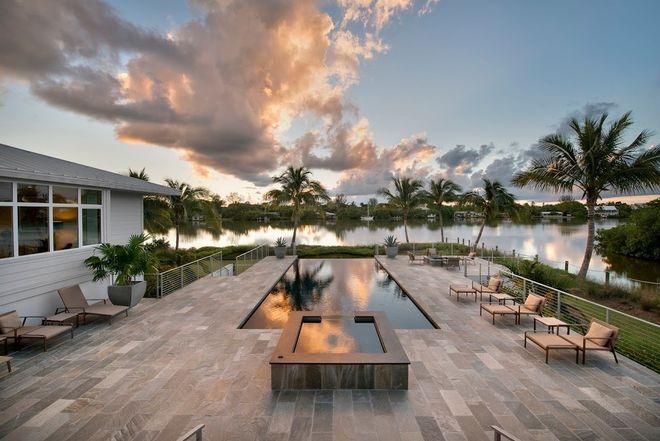 Contemporary Pool by Dan Hahn Custom Builders, Inc.