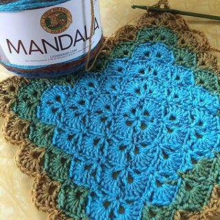 Lion Brand Mandala Yarn In Sphinx Used For Beautiful Shells Blanket Pattern Available At Revelry Lion Brand Mandala Yarn Mandala Yarn Crochet Blanket Rainbow