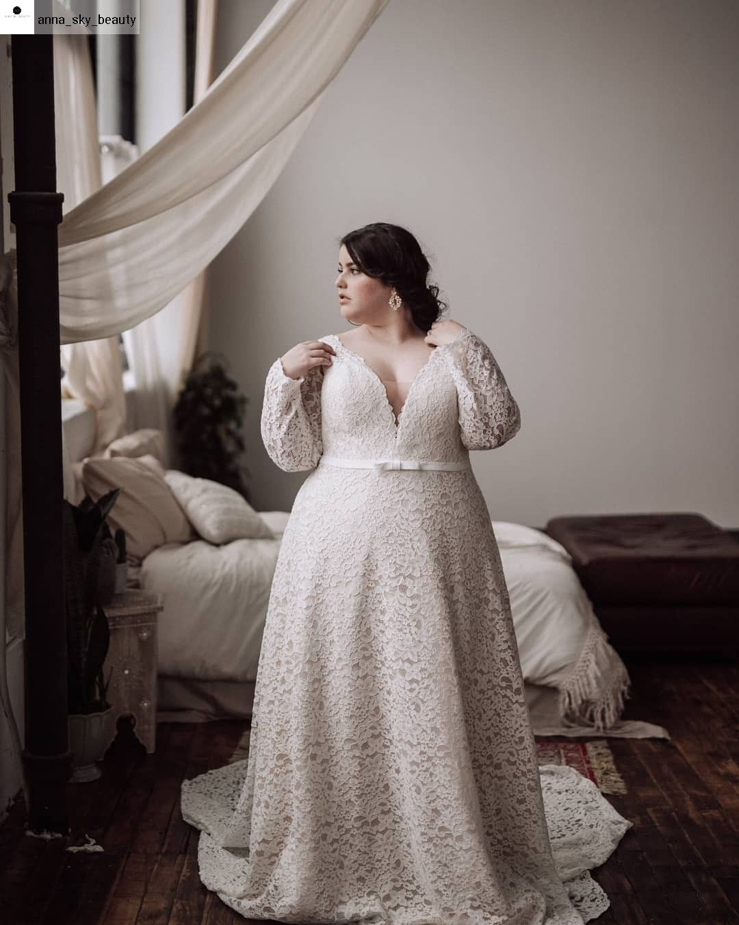 Plus size lace corset wedding gown with long sleeves. Seline