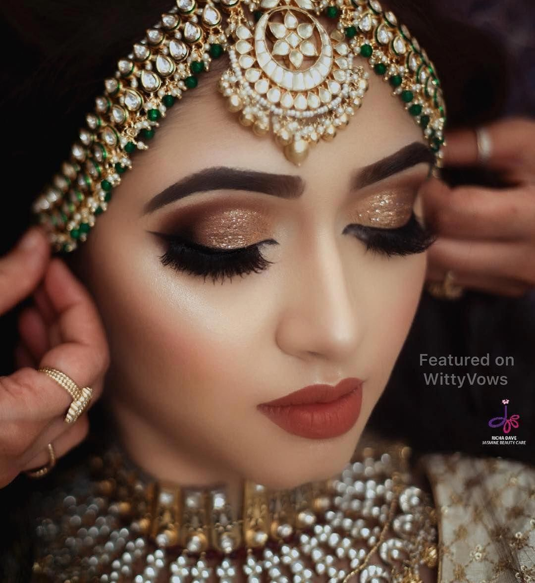 Golden Smokey Eyes Paired With A Dull Red Lip Bridal Makeup
