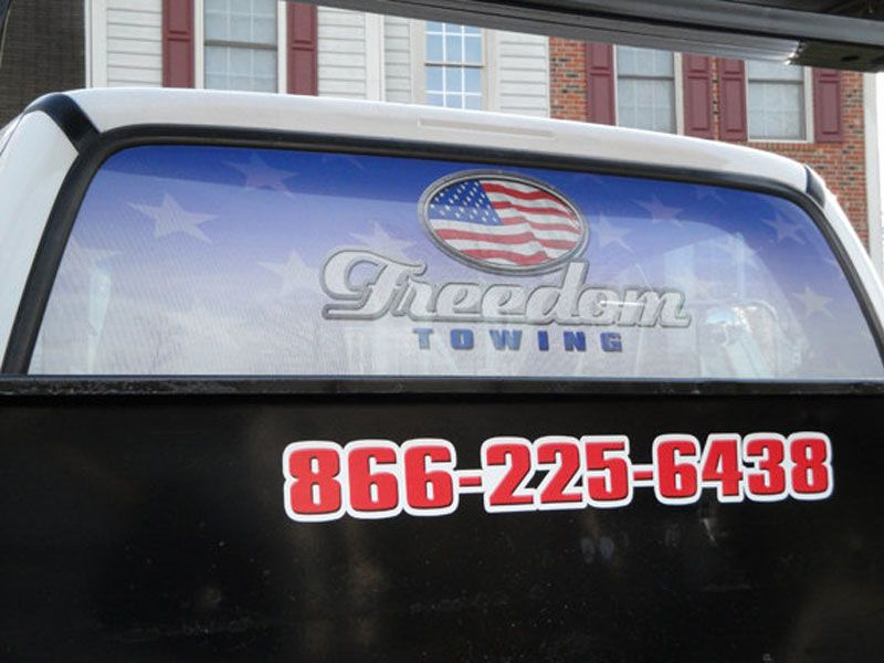 Freedom Towing truck digital printed lettering and