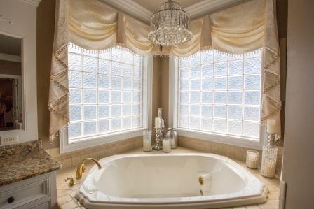 Swags and Cascades wrap luxury around this corner garden tub.