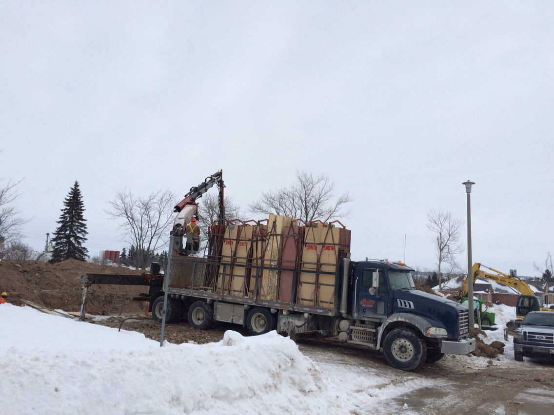 Concrete form truck the concrete forms arrive on a truck and are unloaded with a