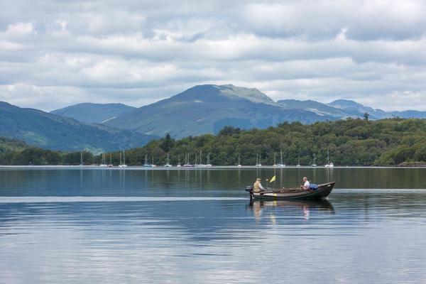Loch Lomond & The Trossachs National Park #lochlomond Two men fish from a boat on Loch Lomond #lochlomond Loch Lomond & The Trossachs National Park #lochlomond Two men fish from a boat on Loch Lomond #lochlomond