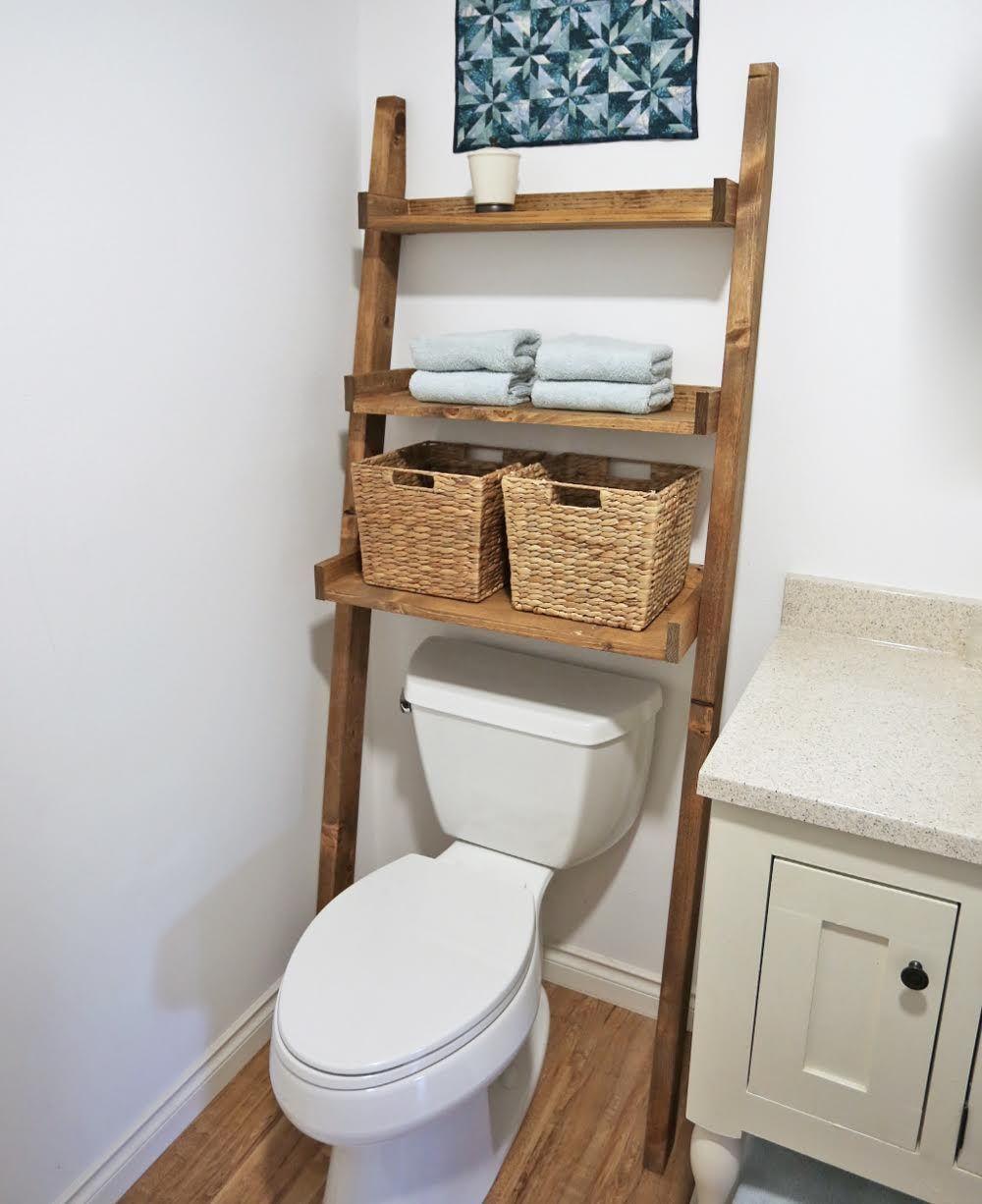 Leaning bathroom ladder over toilet shelf knockoff wood