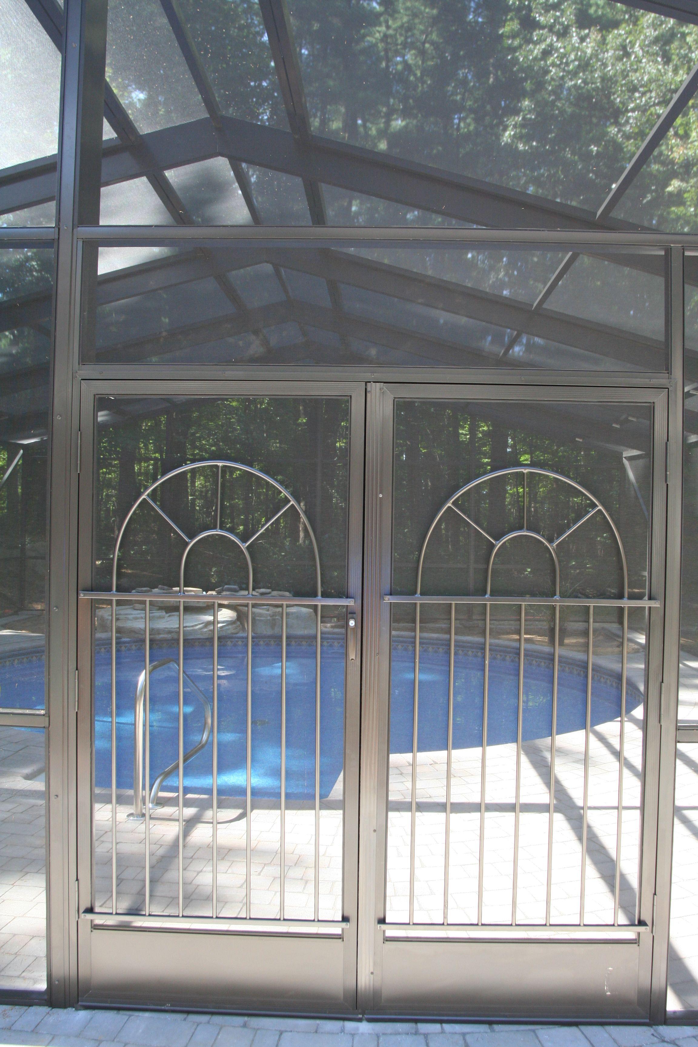 Hemingway style screen door grilles installed on double
