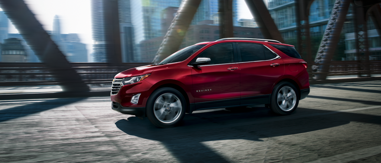 A Red 2019 Chevy Equinox Driving Across A Bridge Chevy Equinox Chevrolet Equinox Chevy