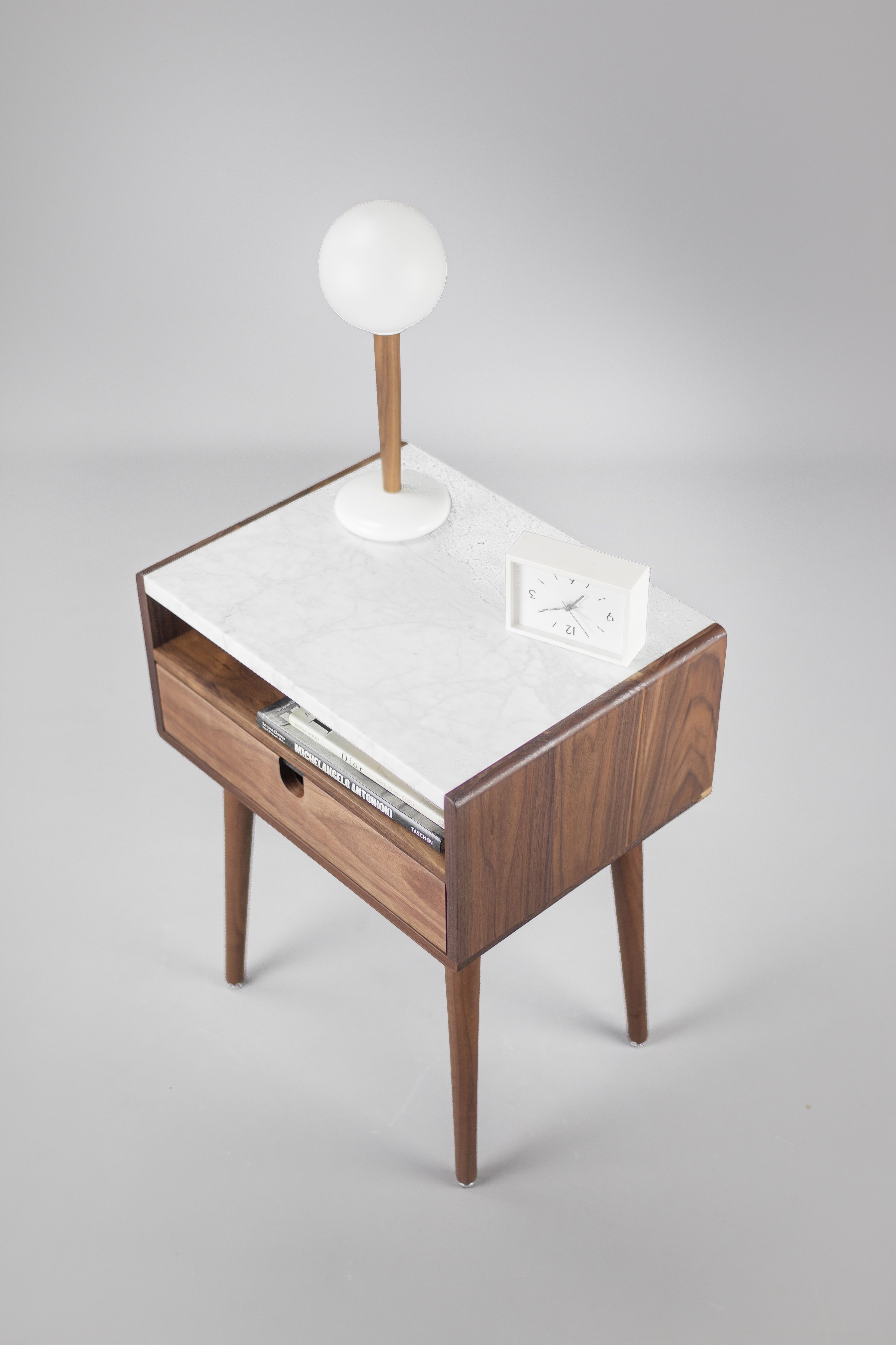 The Classic Design Of Our Walnut Nightstand Reflects Mid Century Modern With Its Clean Lines And Tape Mid Century Nightstand Marble Table Marble Bedside Tables