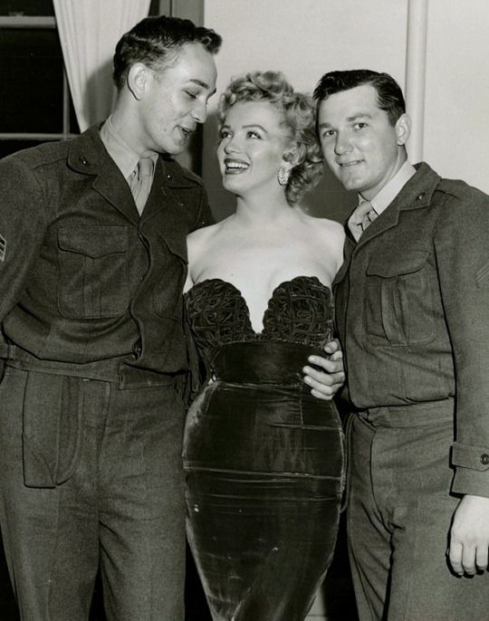 Marilyn with Camp Pendleton Soldiers (someone is in love, and you can see where his eyes are focused!