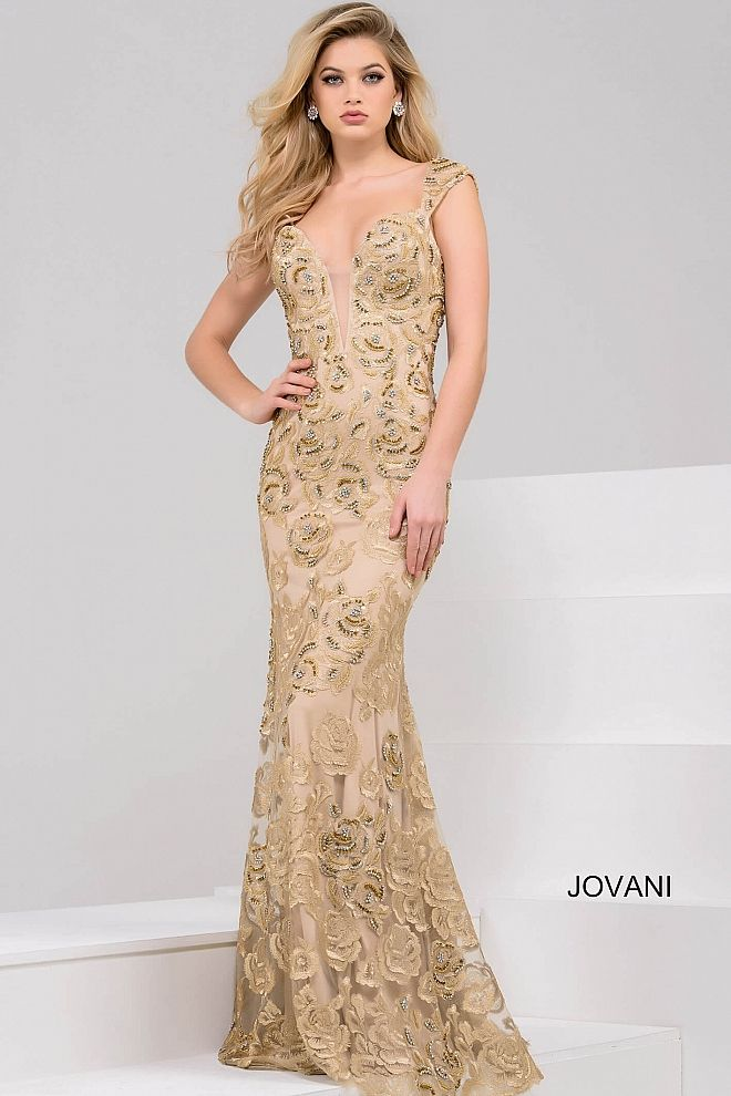 6e854115677 Beautiful floor length form fitting gold lace evening gown with  embellishments features cap sleeve bodice and plunging neckline.
