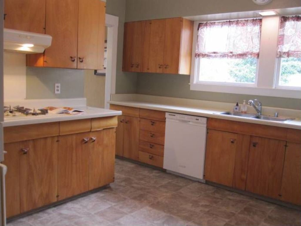 504 Lewis Ave San Leandro Ca 94577 60s Whale Tail Pulls White Counters Wood Cabinets Modern Faux Stone Vinyl And G White Counters Wood Cabinets Home Decor