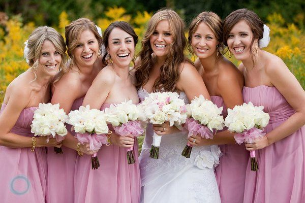 Bridesmaids all dolled up in pink! Love this real wedding in Canada! {Dave & Charlotte, Lifestyle Photographers}