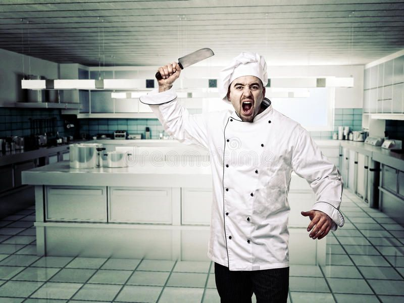 Angry chef portrait of angry chef in modern kitcken
