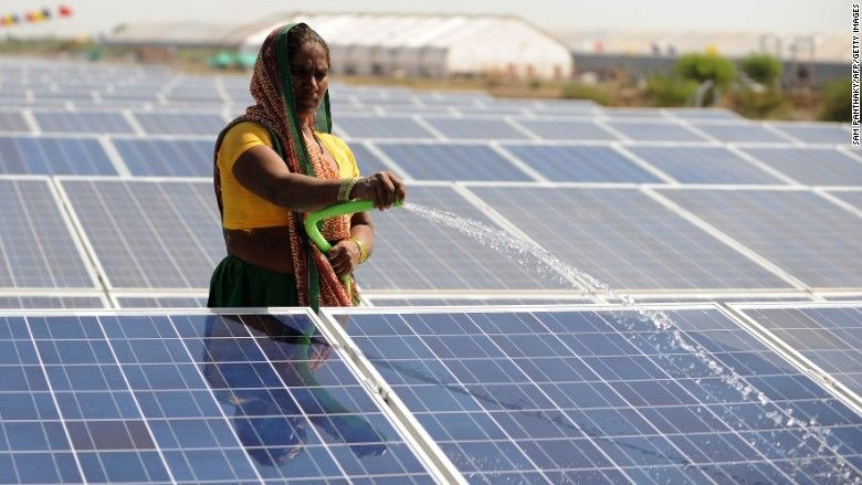 India S Big Move Into Solar Is Already Paying Off Paris Climate Solar Solar Energy