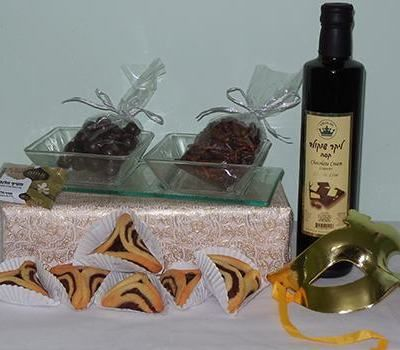 Elegant Shalach Manos from Purimland.com. Zebra Hamentashen with chocolate filling, chocolate liquor and chocolate delicacies in an elegant glass condiments tray.  Send Meshloach Manot in Israel from Purimland.com