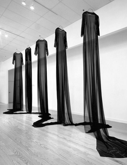 Mary Tuma - homes for the disembodiednext piece  2000, remade 2003. 50 meters of continuous fabric, fallen trees, thread, stones, wire. approximately 10' x 25' x 7' (dimensions variable)