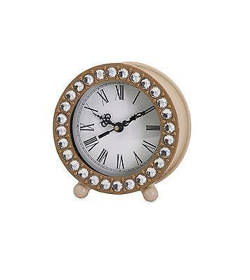 Add A Touch Of Romance With This Round Metal Table Clock
