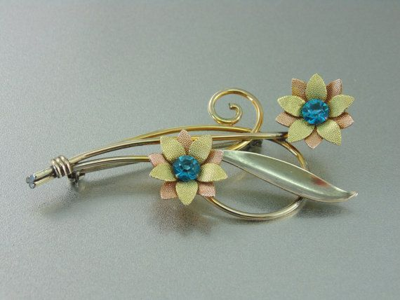 A Vintage Van dell 12K Gold Filled Flower Spray Brooch, Yellow, White, & Rose Gold with Aqua Rhinestones.. The Old Junk Trunk. on Etsy, $42.00
