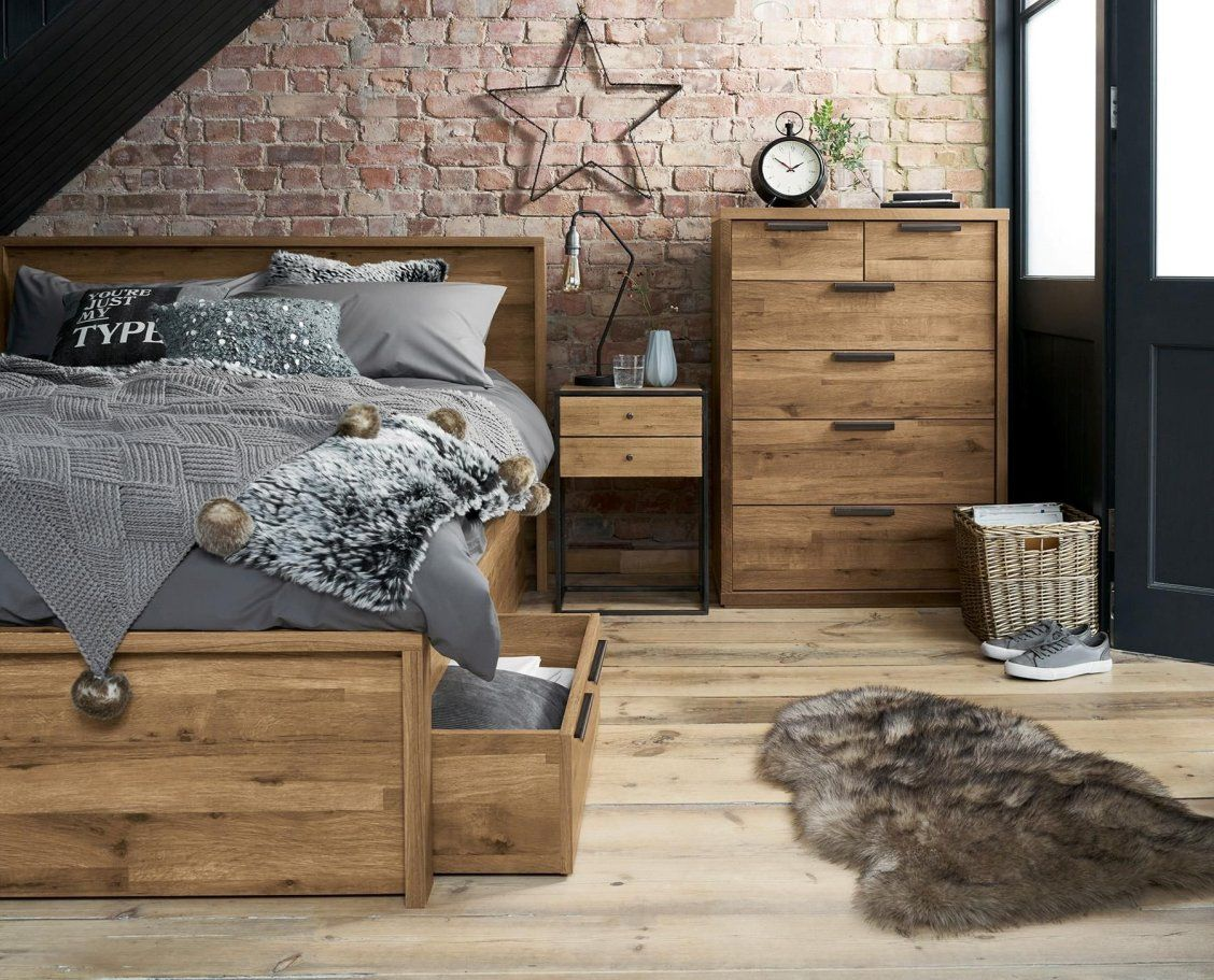 Bedroom goals dark wood teamed with grey bedding and faux fur is