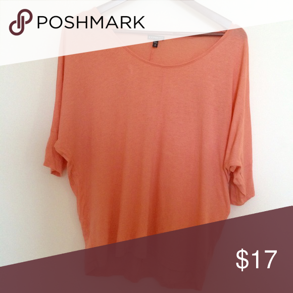 Peach colored light weight loose shirt Great condition! I ship that day  bundle discounts vary on items bough Express Tops