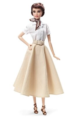 Barbie 2013, Audrey Hepburn in Roman HolidayThis lovely Audrey Hepburn in Roman Holiday portrait doll is exquisitely sculpted to in the actress' likeness. She is dressed in a re-creation of Princess Ann's costume: a beige A-line skirt worn with a crisp white blouse and finished with a wide buckled belt.