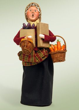 """""""Woman Buying Vegetables"""" a part of the Crier Carolers series."""