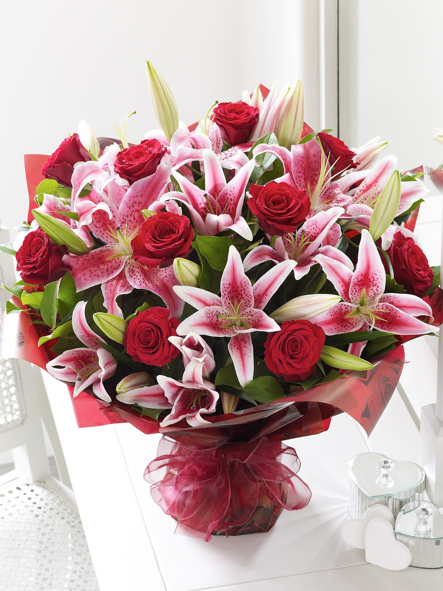 A mix of romantic red roses and sweet smelling Lillies