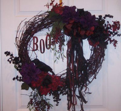 boo wreath...has shredded ribbon, spider hanging, crow, dead florals