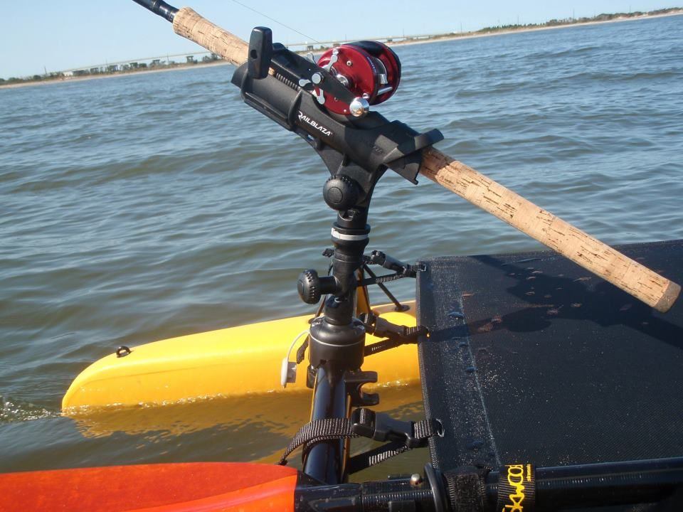 Kayak fishing rod holder elevated off the deck with an adjustable