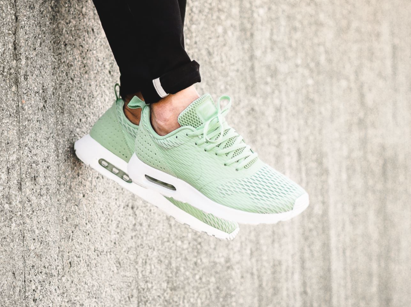 The Nike Air Max Tavas SE is rendered in Enamel Green for