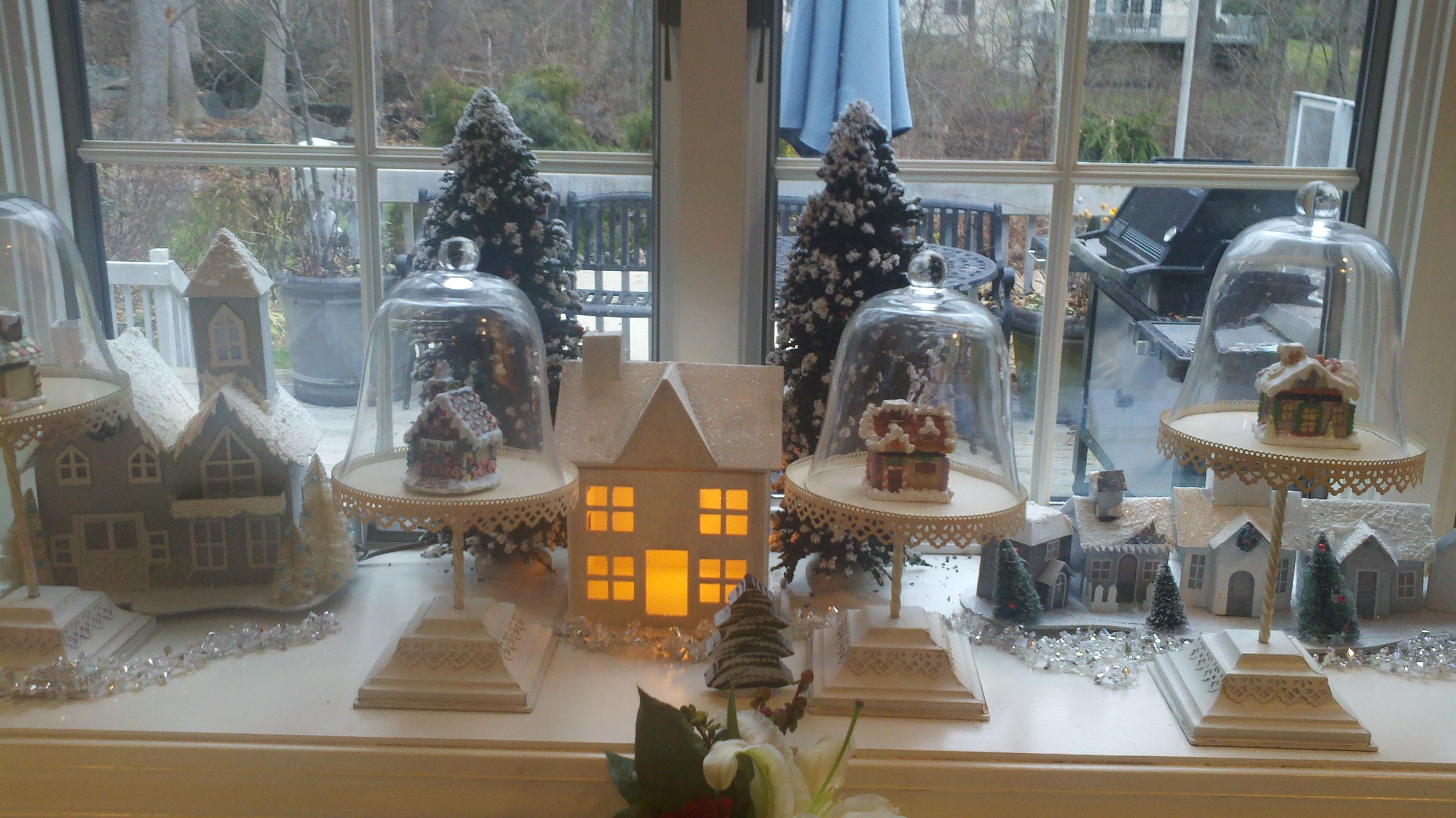 Mini glittered gingerbread houses in cake stands