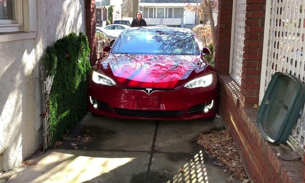 Tesla owner summons model s into frighteningly narrow
