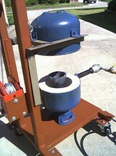 """Homemade foundry fashioned from a surplus Freon tank and equipped with a Venturi-type burner. Capable of accommodating crucibles measuring 3-1/2"""" diameter x ..."""