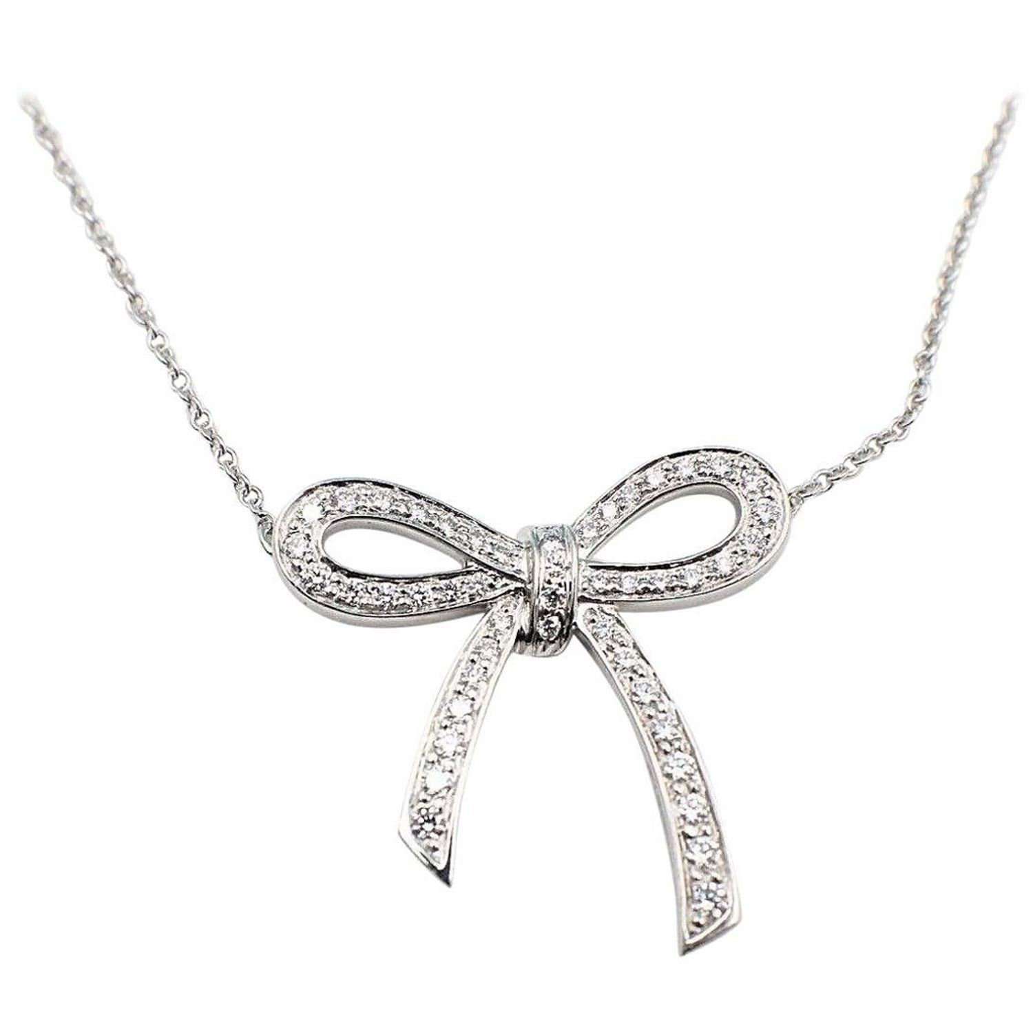 883d3de40d7a0 Tiffany & Co. Diamond and Platinum Bow Pendant Necklace in 2019 ...